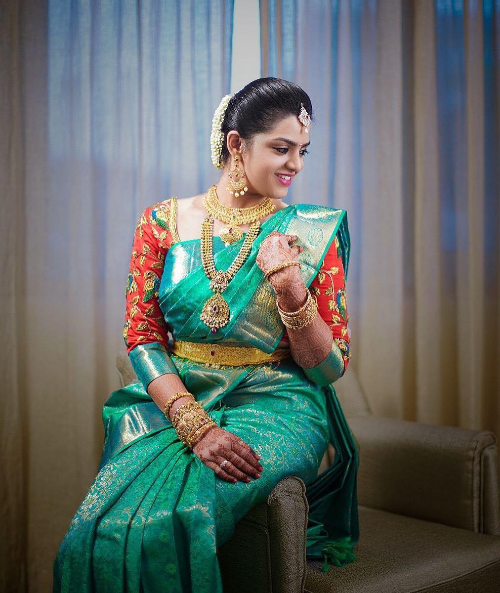 Blue silk saree with red aari work blouse