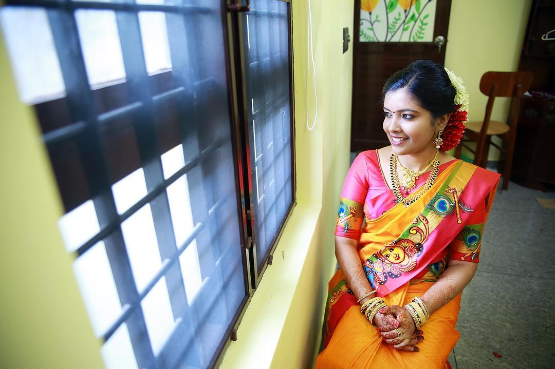 Yellow Silksaree with peacock feather border