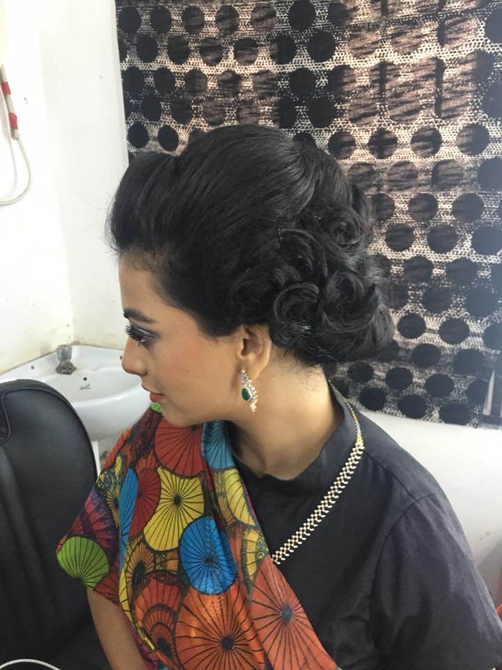 Spiral Bun Hairstlye for Black Lehenga