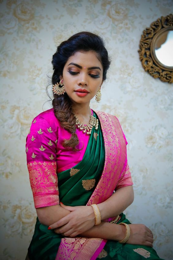Dark green silksaree with traditional pink blouse