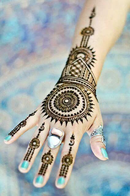 Round arabic design with blue nail polish