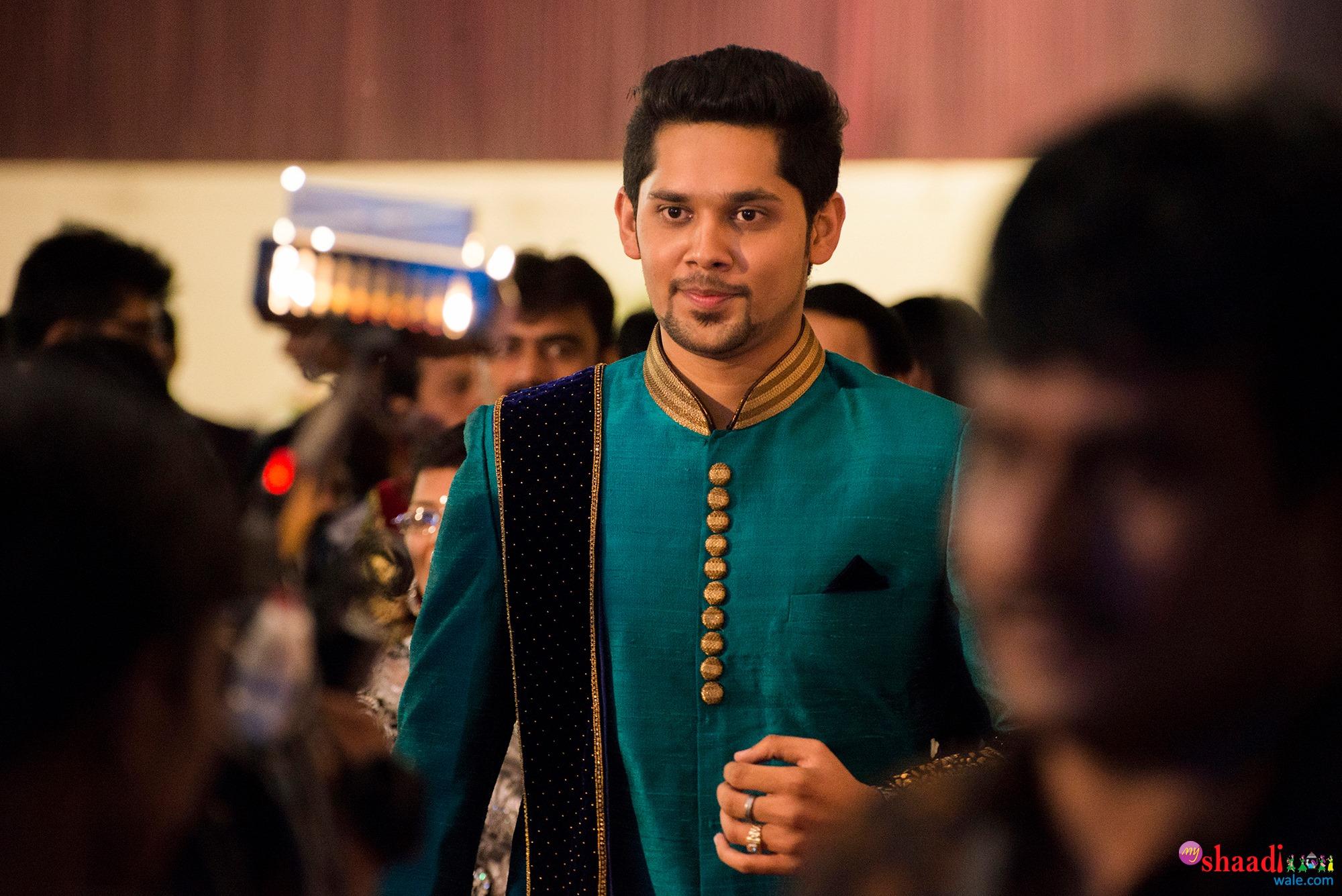 Plain green sherwani with Velvet royal Blue shall