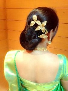 20.lower bun with artificial flower hairstyle