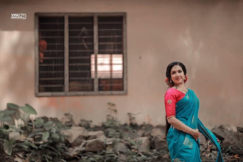 Admiring blue Saree