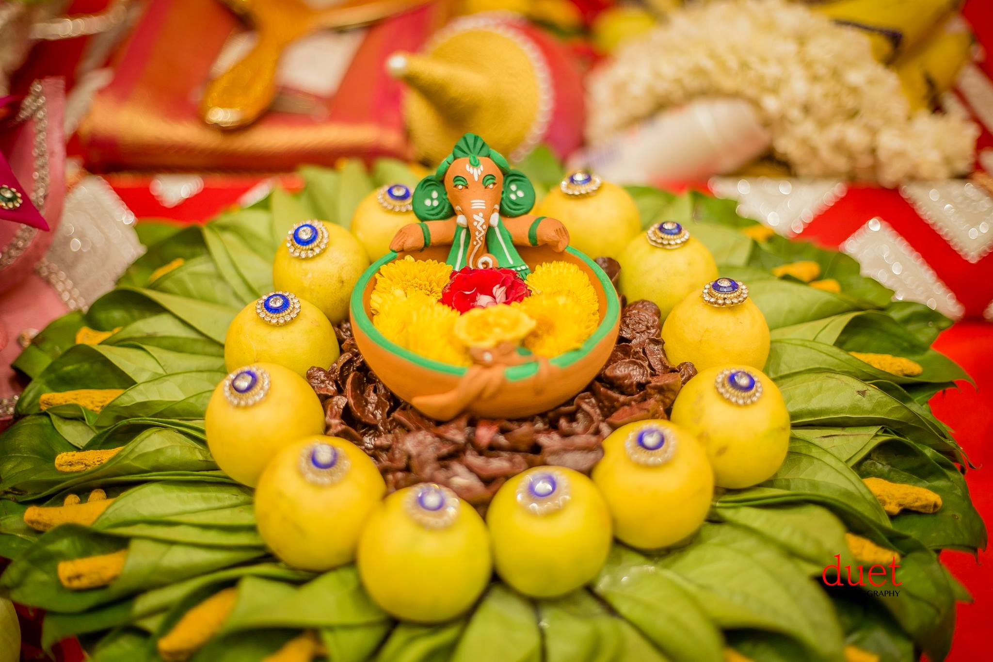 Ganesa in the middle of decorated oranges