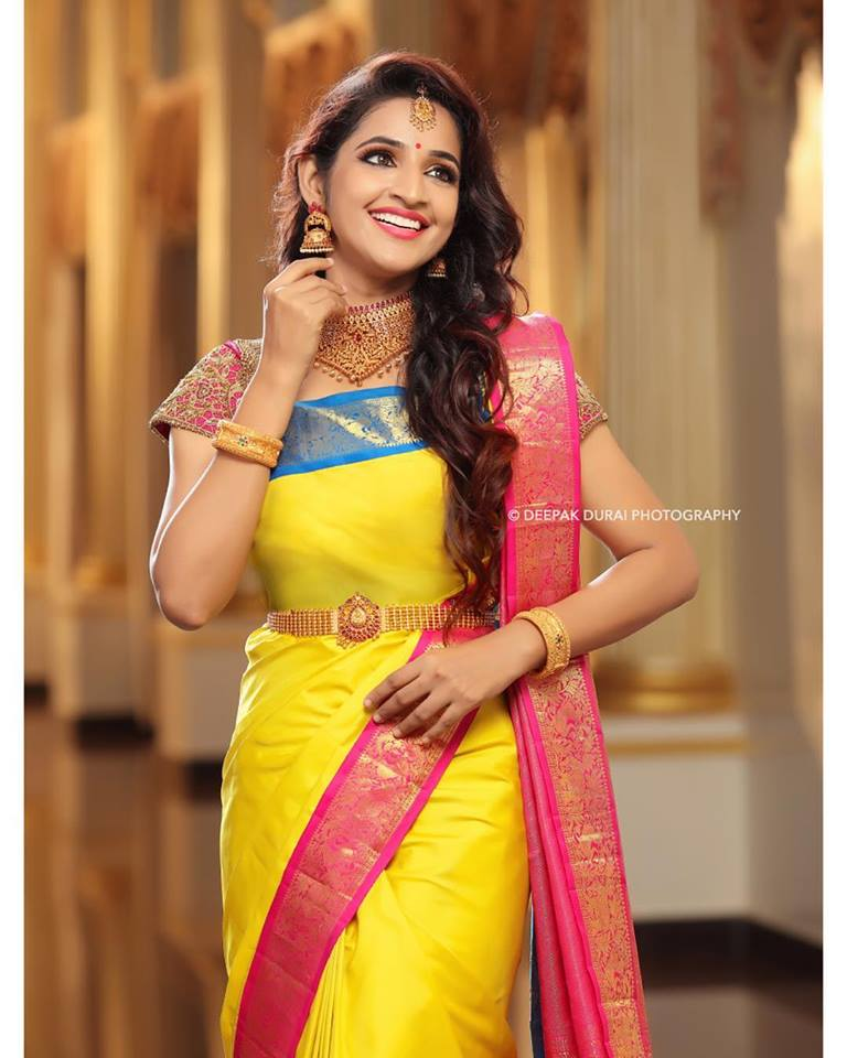 Yellow silksaree with pink and blue border