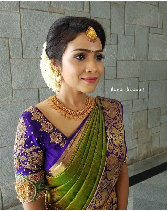 Green Kancivaram silksaree with royal blue border