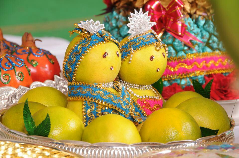 Bride And Groom Decorated In Orange Fruit
