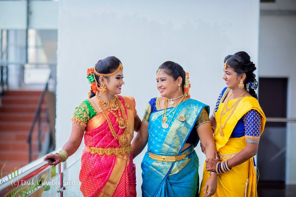 bride with her mom and sis