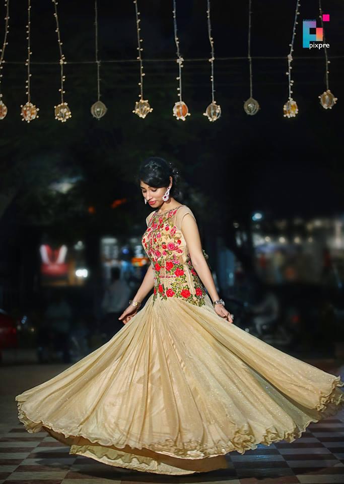 Beige designer Gown with flowers