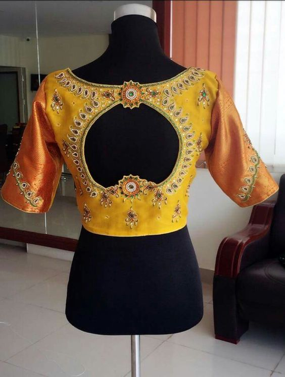 yellow flower back neck blouse design