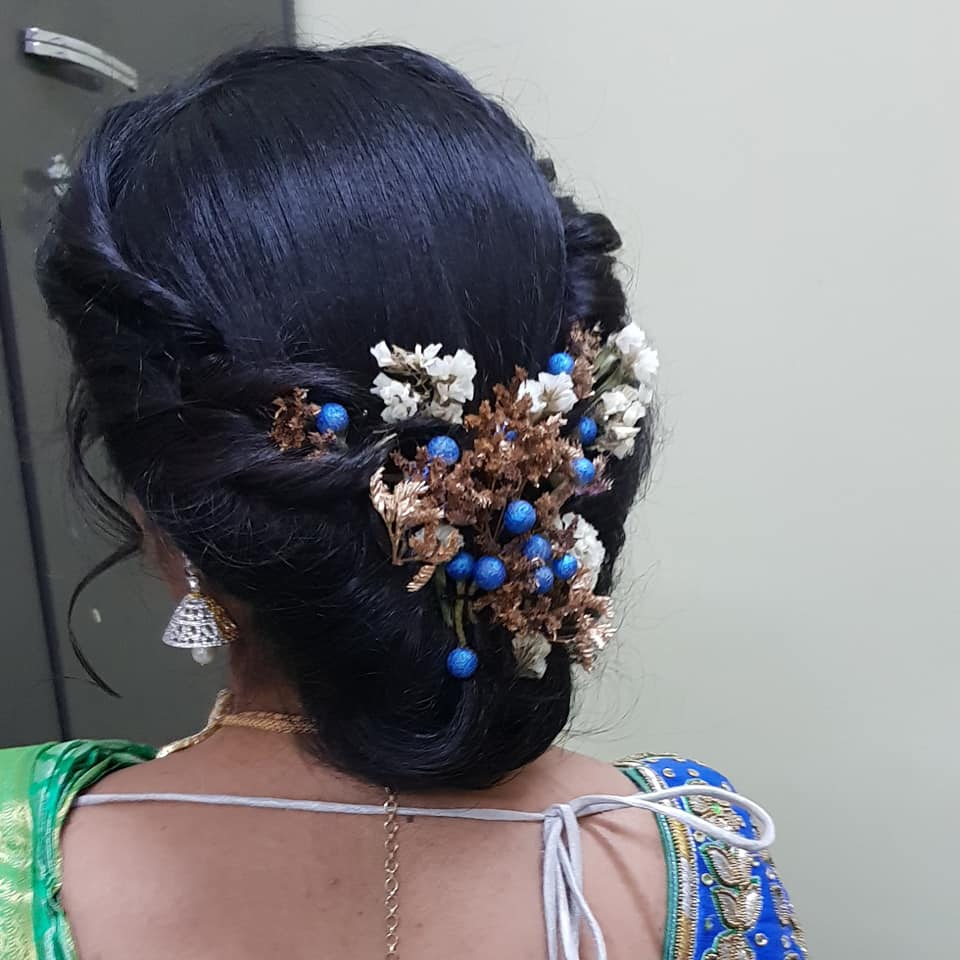 Reception hairstyle  with blue flower