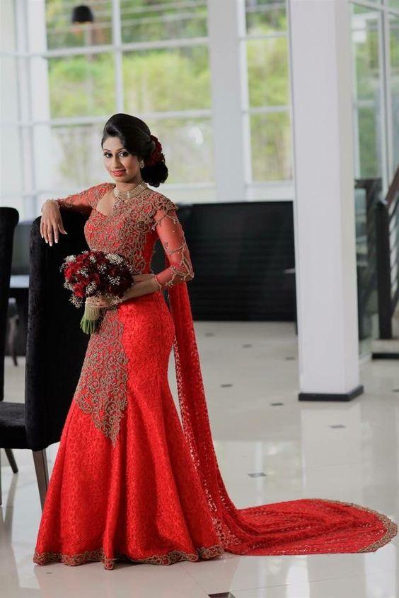 Heavy Work Orange Designer Saree Photo Gallery